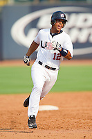 Chris Elder #12 (Oral Roberts) of the USA Baseball Collegiate National Team hustles towards third base against the Japan Collegiate National Team at the Durham Bulls Athletic Park on July 3, 2011 in Durham, North Carolina.  USA defeated Japan 7-6.  (Brian Westerholt / Four Seam Images)