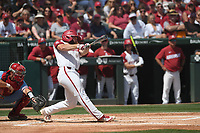 NWA Democrat-Gazette/J.T. WAMPLER Arkansas' Trevor Ezell rips a hit against Ole Miss Monday June 10, 2019 during the NCAA Fayetteville Super Regional at Baum-Walker Stadium in Fayetteville. Arkansas won 14-1 and will advance to the College World Series in Omaha.