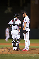 Salt River Rafters relief pitcher Hector Lujan (35), of the Minnesota Twins organization, talks to catcher Daulton Varsho (8), of the Arizona Diamondbacks organization, during an Arizona Fall League game against the Scottsdale Scorpions at Salt River Fields at Talking Stick on October 11, 2018 in Scottsdale, Arizona. Salt River defeated Scottsdale 7-6. (Zachary Lucy/Four Seam Images)