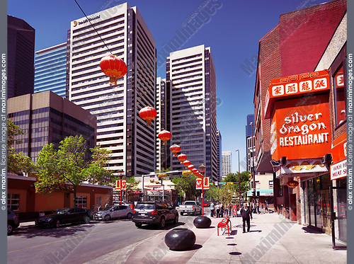 Silver dragon restaurant bright red sign and other shops and restaurants in Chinatown of Calgary, Alberta, Canada. Summertime ueban scenery. Summer 2017.