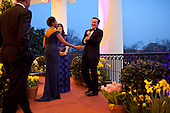 United States President Barack Obama and First Lady Michelle Obama visit with Prime Minister David Cameron of the United Kingdom and Samantha Cameron during an Official Dinner reception on the Truman Balcony of the White House, March 14, 2012. .Mandatory Credit: Pete Souza - White House via CNP