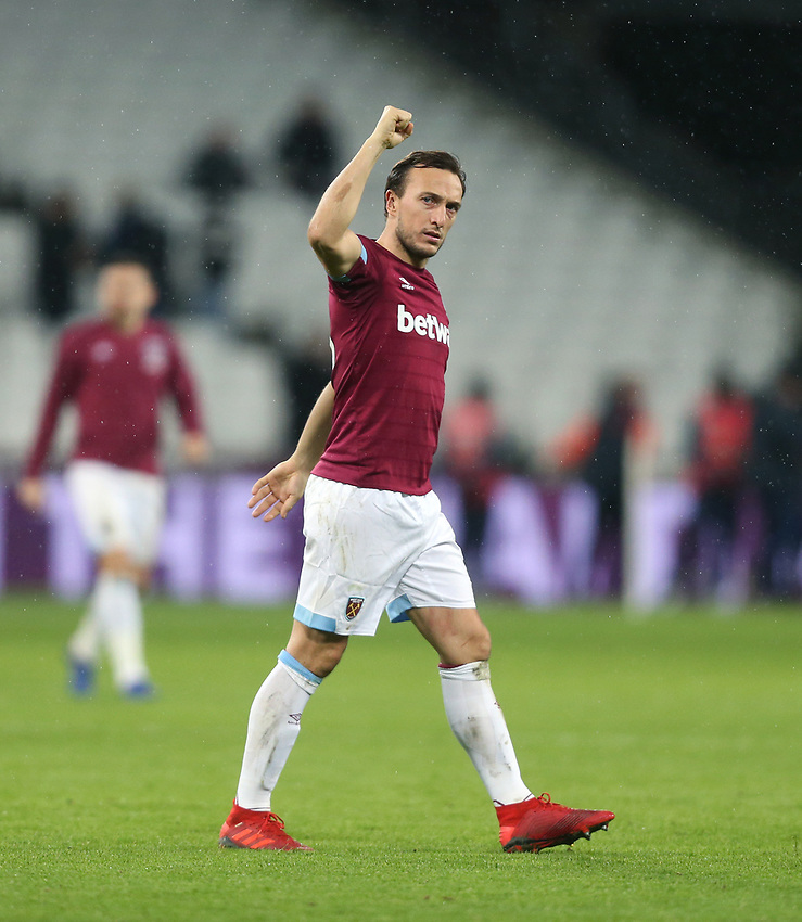 West Ham United's Mark Noble celebrates at the end of the game<br /> <br /> Photographer Rob Newell/CameraSport<br /> <br /> The Premier League - West Ham United v Cardiff City - Tuesday 4th December 2018 - London Stadium - London<br /> <br /> World Copyright © 2018 CameraSport. All rights reserved. 43 Linden Ave. Countesthorpe. Leicester. England. LE8 5PG - Tel: +44 (0) 116 277 4147 - admin@camerasport.com - www.camerasport.com