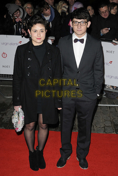 Yasmin Paige & Craig Roberts.attends the London Film Critics' Circle Awards at BFI Southbank, London, England..19th January 2012.full length black jacket coat ankle boots grey gray suit tuxedo bow tie.CAP/CAN.©Can Nguyen/Capital Pictures.