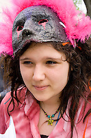 Girl age 11 ready to join parade as part of a masked and costumed troop. MayDay Parade and Festival. Minneapolis Minnesota USA