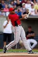 Michael Crouse (21) of the Lansing Lugnuts follows through on his swing during the Midwest League All-Star Home Run Derby at Modern Woodmen Park on June 20, 2011 in Davenport, Iowa. (David Welker / Four Seam Images)