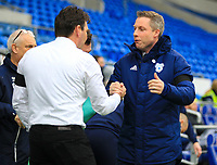 4th January 2020; Cardiff City Stadium, Cardiff, Glamorgan, Wales; English FA Cup Football, Cardiff City versus Carlisle; Neil Harris manager of Cardiff City shake hands with Chris Beech manager of Carlisle United before the match  - Strictly Editorial Use Only. No use with unauthorized audio, video, data, fixture lists, club/league logos or 'live' services. Online in-match use limited to 120 images, no video emulation. No use in betting, games or single club/league/player publications