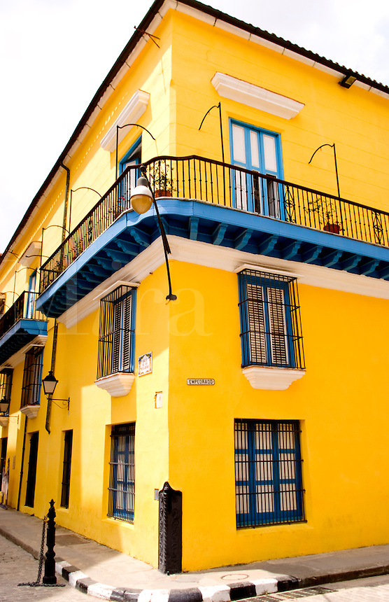 Colorful yellow building in Old Havana in Havana Cuba Habana