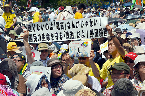 July 16, 2012, Tokyo, Japan - More than 170,000 citizens rally in a mass protest in the scorching summer heat at Tokyos Yoyogi Park, demanding Japanese government bring an end to the countys nuclear power plants on Monday, July 16, 2012. Japanese nobel laureate Kenzabur Oe and renown musician and composer Ryuichi Sakamoto among others participated in the rally, the largest of its kind ever. (Photo by Natsuki Sakai/AFLO)