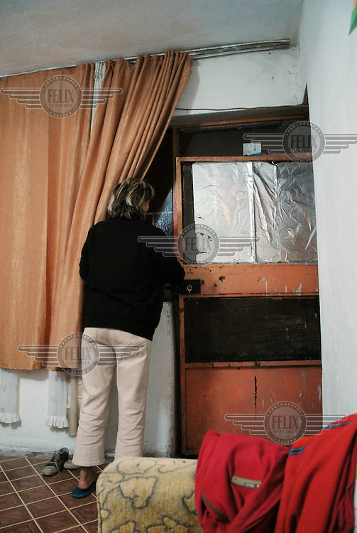 38 year old Sister Eti openes the door to her landlord who has come to complain that she didn't pay the rent for her room last month. Eti is an Iranian refugee. She moved to Turkey because she wanted to become a Christian. Eti says under Islamic law in Iran she would be put to death if she did this. She hopes by telling her story she and other women in her situation will be helped. Eti hopes by telling her story she and other women in her situation will be helped.