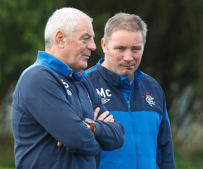 Ally McCoist bites his lip as manager Walter Smith gives him some advice at training