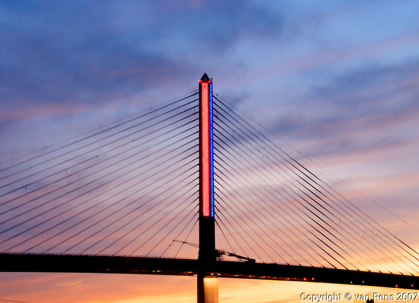 Red LED lights on the tower of the Vet Glass City Skyway bridge on the evening of the inaugural opening