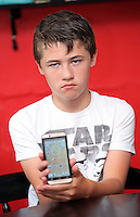 FAO NIGEL BARKLIE, DAILY MAIL PICTURE DESK<br /> Pictured: Mikey Howells at his home in Carmarthen. Thursday 14 July 2016<br /> Re: Lisa Howells from Carmarthen, west Wales is angry after a TT Sims mobile phone she bought for her son Mikey from Tesco seems to have infections that cannot be removed, making the phone access porn sites even after factory re-sets have been done.