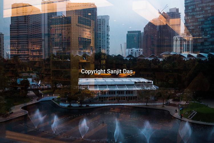 The interiors of a book store is reflected onto the skyline of Kuala Lumpur, Malaysia.