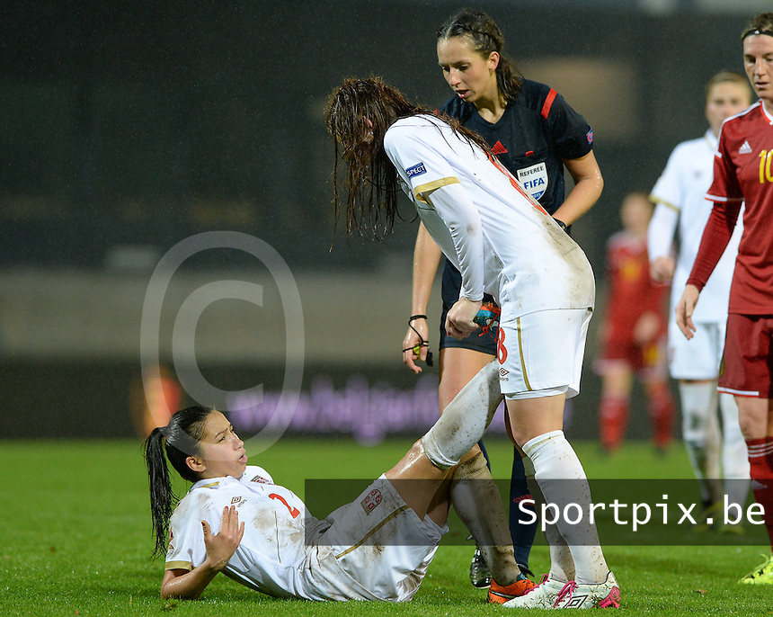 20151130 - LEUVEN ,  BELGIUM : Serbian Jasna Djordjevic pictured with cramps during the female soccer game between the Belgian Red Flames and Serbia , the third game in the qualification for the European Championship in The Netherlands 2017  , Monday 30 November 2015 at Stadion Den Dreef  in Leuven , Belgium. PHOTO DAVID CATRY