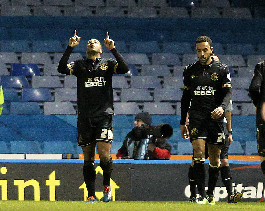 Wigan Athletic's Nicky Maynard celebrates scoring his sides first goal <br /><br />Photo by Mick Walker/CameraSport<br /><br />Football - The Football League Sky Bet Championship - Sheffield Wednesday v Wigan Athletic - Tuesday 11th February 2014 - Hillsborough - Sheffield<br /><br />&copy; CameraSport - 43 Linden Ave. Countesthorpe. Leicester. England. LE8 5PG - Tel: +44 (0) 116 277 4147 - admin@camerasport.com - www.camerasport.com