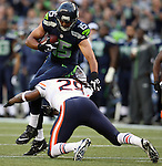 Seattle Seahawks wide receiver Jermaine Kearse (15) is tackled by Chicago Bears safety Danny McCray (29) in the first quarter of a pre-season game at CenturyLink Field in Seattle, Washington on August 22, 2014.   The Seahawks beat the Bears 34-6.  Kearse caught 4 passes for 63 yards and scored one touchdown in the win. ©2014.  Jim Bryant Photo. ALL RIGHTS RESERVED.