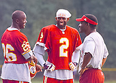 Washington Redskins cornerback Deion Sanders (2) smiles with unidentified teammates at the team's training camp at Redskins Park in Ashburn, Virginia on August 10, 2000.<br /> Credit: Arnie Sachs / CNP