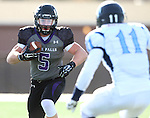 SIOUX FALLS, SD - NOVEMBER 8: Brady Rose #5 from the University of Sioux Falls eyes the defense of Paul Yokas #11 from Upper Iowa in the second quarter of their game Saturday afternoon at Bob Young Field in Sioux Falls.  (Photo by Dave Eggen/Inertia)