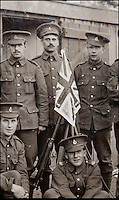 BNPS.co.uk (01202 558833)<br /> Pic: PhilYeomans/BNPS<br /> <br /> Pte William Taylor (centre back) at the start of the war.<br /> <br /> Saved by pictures of his loving family...<br /> <br /> An amazing tale of a heroes lucky survival through the entire First World War has been uncovered after his family revealed his remarkable tale to a local history group.<br /> <br /> Photos of loved ones that saved a soldier's life by stopping a piece of shrapnel aimed for his heart have come to light - complete with the holes the fragment left behind.<br /> <br /> Private William Taylor kept the nine pictures of his family in his wallet in his breast pocket during the entire four years of World War One.<br /> <br /> In a remarkable quirk of fate he survived a battle which left three quarters of his regiment dead or injured thanks to the stack of photos which took the impact of a shell blast.<br /> <br /> The projectile pierced the outer layer of his leather wallet and perforated eight of the nine photos.<br /> <br /> Luckily, the last picture of his younger sister Lilly stopped the fragment from going any further.
