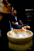 NEW YORK, NY - JUNE 25: Cheese is cooked at a Italian stand during the Summer Fancy Food Show at the Javits Center in the borough of Manhattan on June 23, 2019 in New York, The Summer Fancy Food Show is the largest and biggest specialty food industry event in the continent (Photo by Eduardo MunozAlvarezVIEWpress/Corbis via Getty Image
