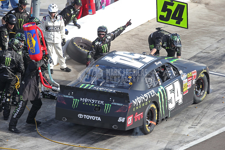 Mar. 2, 2013; Avondale, AZ, USA; NASCAR Nationwide Series driver Kyle Busch pits during the Dollar General 200 at Phoenix International Raceway. Mandatory Credit: Mark J. Rebilas-