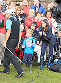 Young Archie Curran from Perthshire has just been handed the ball holed by Paul Lawrie (SCO) to become the 2012 Johnnie Walker Champion: The tournament was played over the PGA Centenary Course, The 2014 Ryder Cup Course, at Gleneagles Hotel, Perthshire from 23rd to 26th August 2012: Picture Stuart Adams www.golftourimages.com: 26th August 2012
