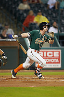 Cameron Baranek (7) of the Greensboro Grasshoppers follows through on his swing against the West Virginia Power at First National Bank Field on June 1, 2018 in Greensboro, North Carolina. The Grasshoppers defeated the Power 10-3. (Brian Westerholt/Four Seam Images)