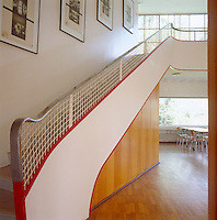 The curved staircase is orientated diagonally to the rest of the house softening its more linear qualities