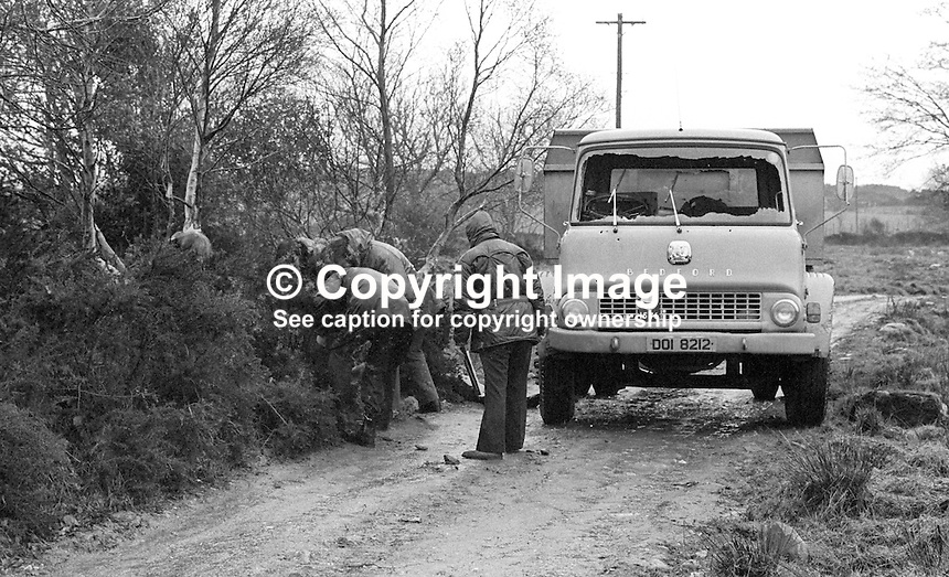 Police at scene of fatal shooting of Michael McHugh, 32 years, married, 2 children, Roman Catholic, from Corgary, Castlederg, Co Tyrone, N Ireland, 21st January 1977.  Michael, forestry worker, Dept of Agriculture, had just driven a short distance from his home when he was stopped and shot by armed men. Mr McHugh's murder was admitted by the UFF, a cover name used by the UVF. In November 1987 two men were jailed for Mr McHugh's murder. 197701210023<br />