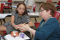 OrigamiUSA 2016 Convention at St. John's University, Queens, New York, USA. Sandra Richman, New York, teaches a class Star Dish. Creasers in Sandra's class.