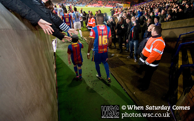 Crystal Palace 1 Huddersfield Town 1, 22/12/2012. Selhurst Park, Championship. Promotion chasing Crystal Palace aim to halt a poor run of form against lowly Huddersfield. The much coveted Wilfried Zaha takes to the field with young mascot. Photo by Simon Gill.