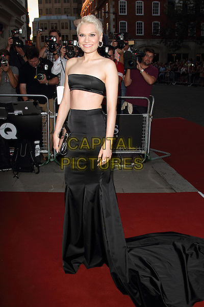 Jessie J (Jessica Ellen Cornish)<br /> GQ Men of the Year Awards 2013 at the Royal Opera House, London, England.<br /> September 3rd, 2013<br /> full length skirt belly stomach midriff clutch bag black strapless bandeau top cropped train<br /> CAP/ROS<br /> &copy;Steve Ross/Capital Pictures