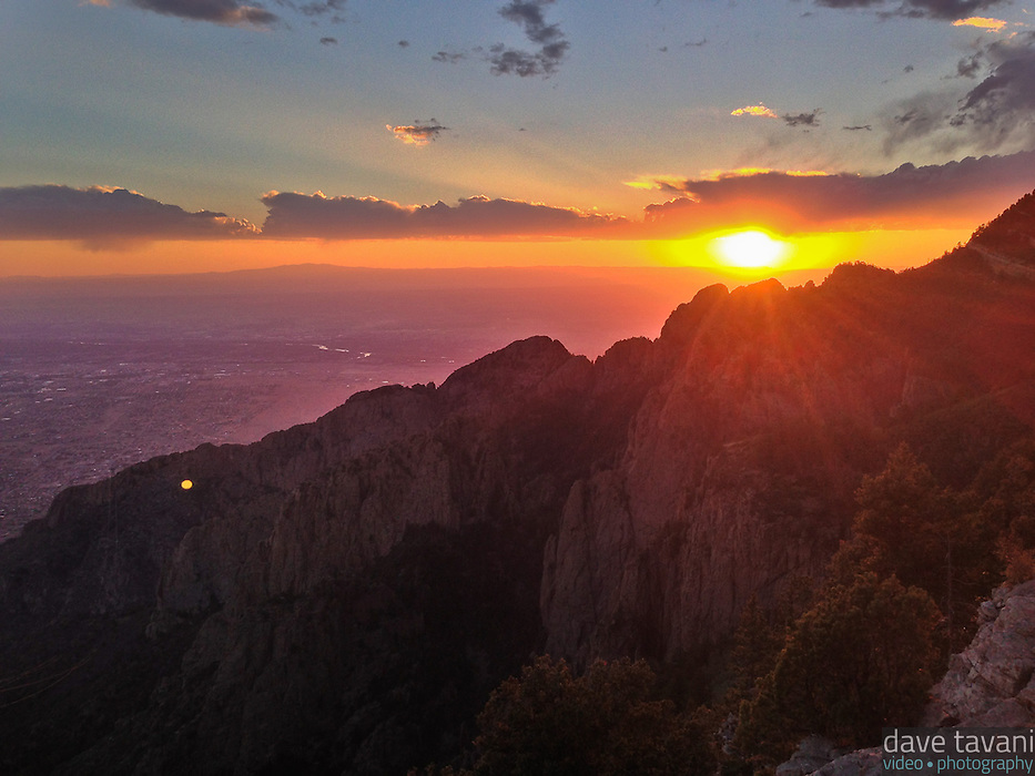 The sun sets over the Albuquerque and the Rio Grande Valley, as seen from Sandia Peak.