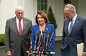 Speaker of the United States House of Representatives Nancy Pelosi (Democrat of California), center, speaks to reporters at the White House in Washington, DC after a meeting with US President Donald J. President Donald J. Trump  on Wednesday, October 16, 2019.  At left is US House Majority Leader Steny Hoyer (Democrat of Maryland) and at right is US Senate Minority Leader Chuck Schumer (Democrat of New York).<br />