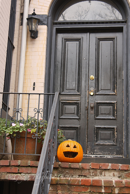 Jack-o-lantern on door step.
