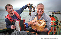 2-7-2012: 'Ta Siad af teacht'!. Former Kerry footballer Paidi O'Se and his son Padraig pictured rowing a traditional currach laden down with with crubeens, spare ribs, lobster  and local vegetables arriving at Cuan Pier, Ventry, County Kerry on Monday for the launch of the annual 'Scleip an t-Samhraidh (Tearaway Week)  which will take place July 16th-22nd in Ventry.<br /> Ceoil, bia agus craic will herald in the exciting fextival which includes a 50k cycle led by Mike Galwey, defenses tug of war competition and sheep dog trials and a special perfromance by Dolores Keane. The weeklong festival will begin with smoked makerel directly from the sea served with summer salad  and will end on Saturday with a  trditional feasting on spare ribs, crubeens and lobster barbque.<br /> Picture by Don MacMonagle<br /> <br /> further info Paidi O'Se 0860548245