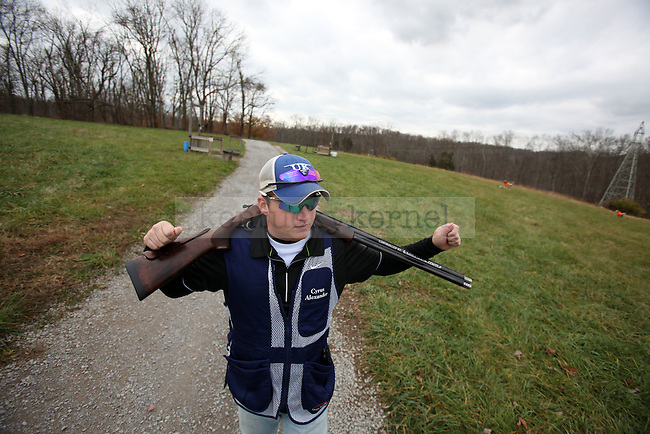 Vice President of sporting clays Cyrus Alexander walks to a station with his gun on Thursday, Nov. 19, 2009 at the Bluegrass Sportsman League in Wilmore, Ky