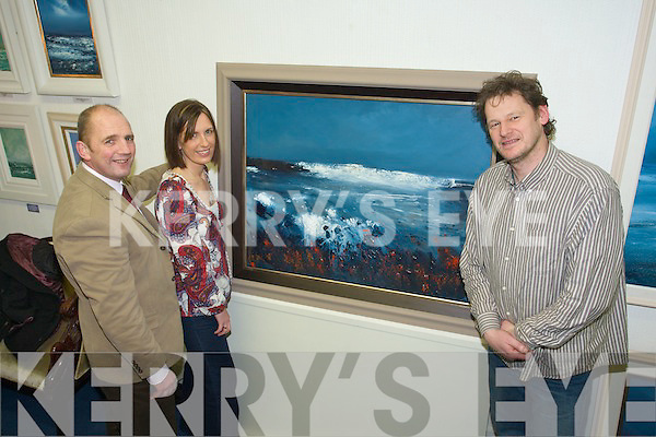 WINNER: Siobha?n Stack from Listowel who won the Kerry's Eye competition for a specially commissioned painting by Tralee artist, John Hurley, with Sales and Marketing manager of Kerry's Eye, Brendan Kennelly and John Hurley on Monday.