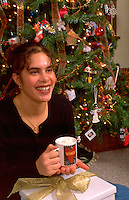 Tongan American age 18 enjoying Christmas at home. St Paul Minnesota USA