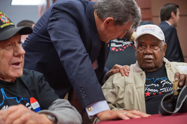 UNITED STATES - MAY 20: Sen. Joe Manchin, D-W.Va., greets Sgt. John M. Watson, 96, of Beckley, W.Va., right, as Korean war vet Billy Cooper, 85, of Milton, W.Va., looks on, during a luncheon in the Capitol Visitor Center where Watson received a Congressional Gold Medal and was recognized by the Tuskegee Airmen Association, May 20, 2015. (Photo By Tom Williams/CQ Roll Call)