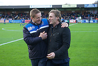 Manager Neal Ardley of AFC Wimbledon greets Manager Gareth Ainsworth of Wycombe Wanderers (right) before the Sky Bet League 2 match between AFC Wimbledon and Wycombe Wanderers at the Cherry Red Records Stadium, Kingston, England on 21 November 2015. Photo by Alan  Stanford/PRiME.