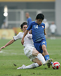 07 August 2008: Sacha Kljestan (USA) (16) tries to tackle the ball away from Shinji Kagawa (JPN) (14).  The men's Olympic team of the United States defeated the men's Olympic soccer team of Japan 1-0 at Tianjin Olympic Center Stadium in Tianjin, China in a Group B round-robin match in the Men's Olympic Football competition.