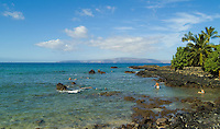 Tourists enjoy snorkeling in the shallow coral beds of Ahihi Bay on the Makena coast of West Maui.