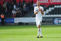 Mike van der Hoorn of Swansea City applauds the fans at the final whistle during the Sky Bet Championship match between Swansea City and Rotherham United at the Liberty Stadium in Swansea, Wales, UK.  Friday 19 April 2019