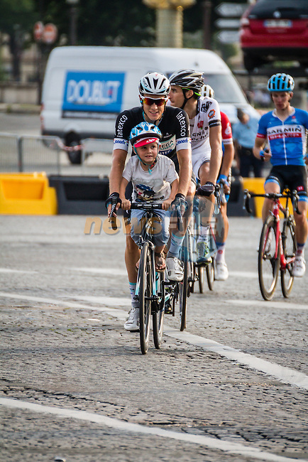 Niki Terpstra (NED) of Omega Pharma - Quick-Step with his kid after finishing, Tour de France, Stage 21: Évry > Paris Champs-Élysées, UCI WorldTour, 2.UWT, Paris Champs-Élysées, France, 27th July 2014, Photo by Pim Nijland
