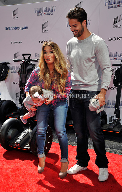 WWW.ACEPIXS.COM<br /> <br /> April 11 2015, New York City<br /> <br /> Jessie James Decker (L), Eric Decker and their Daughter arriving at the 'Paul Blart: Mall Cop 2' New York Premiere at AMC Loews Lincoln Square on April 11, 2015 in New York City.<br /> <br /> By Line: Curtis Means/ACE Pictures<br /> <br /> <br /> ACE Pictures, Inc.<br /> tel: 646 769 0430<br /> Email: info@acepixs.com<br /> www.acepixs.com