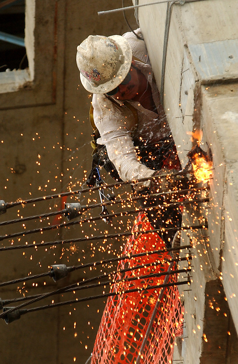 construction/052703 - A worker uses a torch at the construction site of Station Place at 2nd and F Sts., NE.