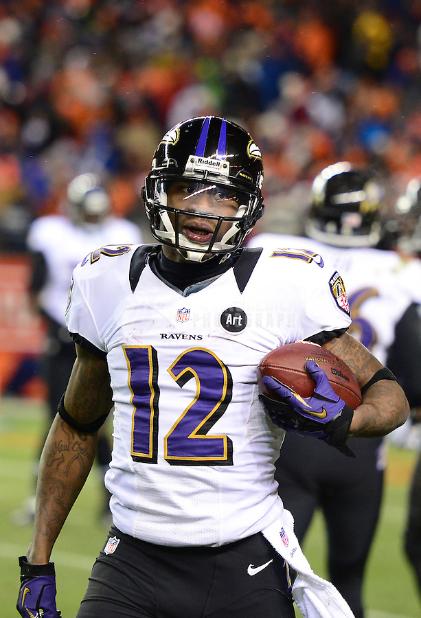 Jan 12, 2013; Denver, CO, USA; Baltimore Ravens wide receiver Jacoby Jones (12) against the Denver Broncos during the AFC divisional round playoff game at Sports Authority Field.  Mandatory Credit: Mark J. Rebilas-