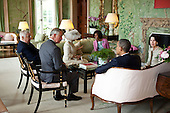 President Barack Obama and First Lady Michelle Obama talk with the Prince of Wales and the Duchess of Cornwall, U.S. Ambassador Louis Susman and Mrs. Margaret Susman at Winfield House in London, England, May 24, 2011. .Mandatory Credit: Pete Souza - White House via CNP