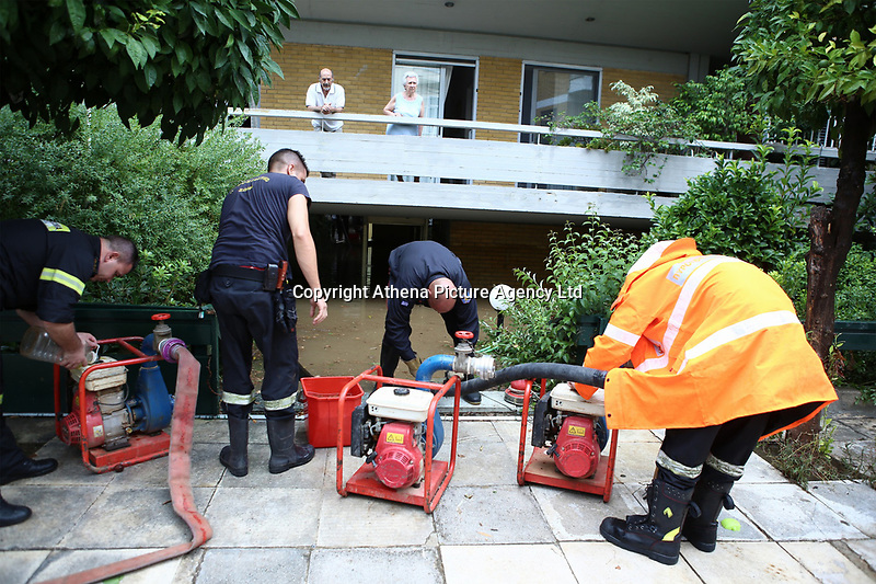 Pictured: Fire service personnel help drain water from properties in the Chalandri suburb of Athens, Greece. Sunday 29 July 2018<br /> Re: Flash-flooding after heavy rainfall in parts of Athens, Greece.